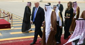 US president Donald Trump is welcomed by Saudi King Salman bin Abdulaziz al-Saud upon arrival at King Khalid International Airport in Riyadh. Photograph: Mandel Ngan/AFP/Getty Images