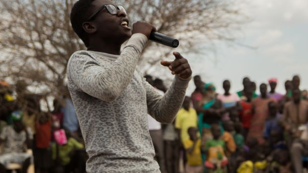 "Singer STIB performs his song ""Sorry"", an apology for the girlfriend he was forced to leave behind in Burundi, as part of the Kakuma's Got Talent audition. Photograph: Ruairi Casey"