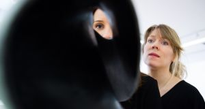 Kate Mc Bride, Kildare with Michelle Considine from Malahide, looking at Eilis O'Connell's bronze sculpture entitled Angular Momentum, which was shortlistlisted for the RCSI Art Award, Varnishing Day, at the RHA.Photo Kenneth O Halloran