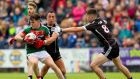 Fergal Boland tries to escape the attentions of Neil Ewing and Patrick O'Connor during Mayo's win over Sligo. Photograph: James Crombie/Inpho