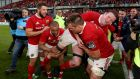 Munster's Simon Zebo and fellow teammates try to lift Donnacha Ryan into the air at the end of the game. Photo: Tommy Dickson/Inpho