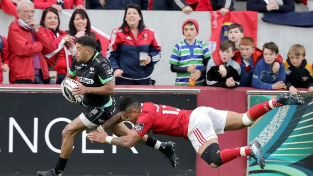 Ospreys' Keelan Giles is denied a late try by Munster's Francis Saili at Saturday's Guinness Pro12 semi-final at Thomond Park, Limerick. Photograph: Morgan Treacy/Inpho