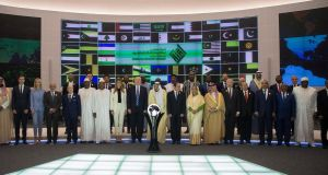 US  President Donald Trump's advisor Jared Kushner, President Trump's assistant Ivanka Trump, Egyptian President Abdel Fattah al-Sisi, US President Donald  Trump, King Salman bin Abdulaziz al-Saud  of Saudi Arabia, US First Lady Melania Trump and other delegates pose for a group photo at the opening of the World Center for Countering Extremist Thought in Riyadh, Saudi Arabia. Photograph: EPA/Saudi Press Agency
