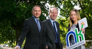 Glen Bailey, head of residential sales, Energia with Minister Shane Ross TD and Ciara Fox, chief operations officer, NK Communications, which plans to hire 25 new sales staff. Photograph: Shane O'Neill
