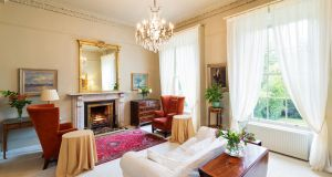 There are matching marble fireplaces, centre roses, elaborate cornicing and sash windows with working shutters in the interconnecting reception rooms.