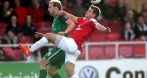Cork's Karl Sheppard and Regan Donelon of Sligo compete for a high ball. Photograph: Bryan Keane/Inpho