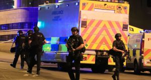 Armed police at Manchester Arena after reports of the explosion. Photograph. Peter Byrne/PA