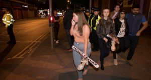 Concert goers react after fleeing the Manchester Arena where Ariana Grande had been performing. Photograph: Jon Super/Reuters