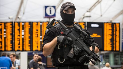 An armed police officer stands at Manchester Piccadilly railway station in Manchester, U.K., on Tuesday, May 23, 2017. At least 22 people were killed in a suicide bombing at a pop concert packed with children in the northern English city of Manchester, in the worst terror incident on British soil since the London bombings of 2005. Photographer: Matthew Lloyd/Bloomberg
