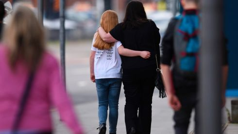 A woman and a girl wearing a t-shirt of US singer Ariana Grande leave a hotel near the Manchester Arena.  Photograph: Oli SCARFF/AFP/Getty Images