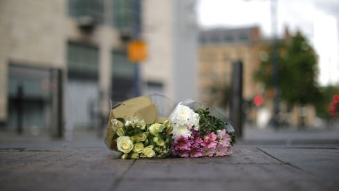 The first floral tributes to the victims of the terrorist attack. Photograph: Christopher Furlong/Getty Images