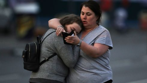 Vikki Baker and her daughter Charlotte, aged 13, leave the Park Inn where they were given refuge after last night's explosion at Manchester Arena. Photograph: Christopher Furlong/Getty Images