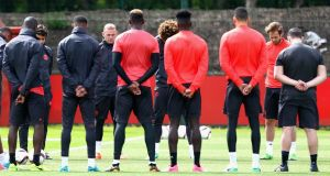 Manchester United players and staff hold a minute silence on Tuesday in memory of the victims of the Manchester concert attack. Photograph: PA
