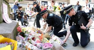 Flowers are left in St Ann's Square, Manchester, the day after an explosion tore through fans leaving a pop concert in Manchester. Photograph: Martin Rickett/PA