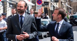 French president Emmanuel Macron and prime minister Edouard Philippe on their way to sign a book of condolences at the British embassy  in Paris for the 22 people killed in the Manchester terrorist attack. Photograph: Etienne Laurent/AFP/Getty Images