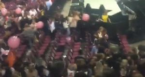 Screen  grab taken from a  video taken at the Ariana Grande concert and released on Twitter @HANNAWWH
