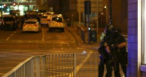 Armed officers near the Manchester Arena after last night's suicide attack. Photograph: Nigel Roddis/EPA