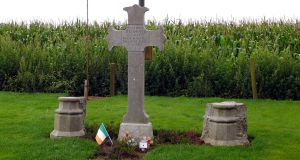 Willie Redmond's grave. Nearby, in  Locre Hospice Cemetery, his   former comrades repose beneath the more conventional headstones of the Commonwealth War Graves Commission