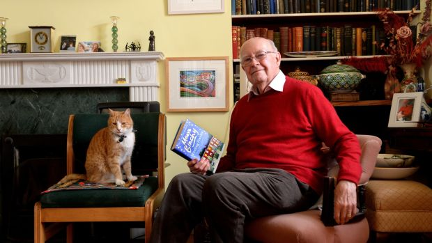 Gordon Snell and Fred the cat at home in Dalkey. Photograph: Cyril Byrne