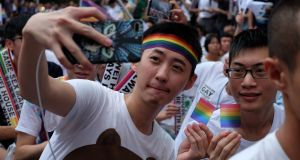 Supporters of LGBT rights celebrate the landmark decision paving the way for Taiwan to become the first place in Asia to legalise same-sex marriage, in Taipei on Wednesday. Photograph: Sam Yeh/AFP/Getty Images