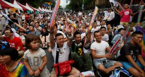 Marriage equality supporters celebrate outside the  constitutional court in Taipei after its ruling on Wednesday in favour of same-sex marriage. Photograph: Ritchie B Tongo/EPA