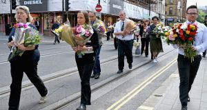 FLORAL TRIBUTES: Manchester City Council workers move floral tributes from Albert Square in Manchester to St Anns Square on in the wake of the suicide blast at an Ariana Grande show at Manchester Arena on Monday, May 22nd, which took the lives of 22 people and left 59 injured. Photograph: Jeff J Mitchell/Getty Images