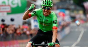 France's Pierre Rolland of  Cannondale-Drapac celebrates as he crosses the finish line to win the 17th stage of the 100th Giro d'Italia from Tirano to Canazei. Photograph: Luk Benies/AFP/Getty Images