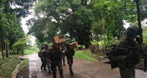 Philippine troops arrive to reinforce fellow troops, on the outskirts of Marawi City in the southern Philippines. Photograph: AP Photo