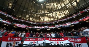 Manchester United fans support their team at Friends Arena. Photograph: Getty Images