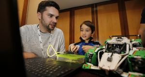 CoderDojo Co-Founder James Whelton and 9-year-old coder Michael Comiskey: Beginning with one club in Cork in 2011, the open-access programming movement has grown to become a global network of 1,250 clubs across almost 70 countries. Photograph:  Nick Bradshaw