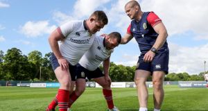Tadhg Furlong and  Jack McGrath work with Lions scrum coach Graham Rowntree during a session at Carton House. Photograph:  Dan Sheridan/Inpho