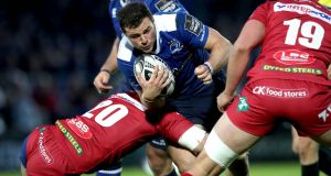 The Scarlets close down Leinster's Robbie Henshaw in the Guinness Pro12 semi-final at the RDS. Photograph: Ryan Byrne/Inpho