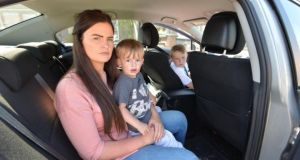 Cheryl Barnewell with her children Clayton  (9) and Rocco (23 months), who ended up having to sleep overnight in their car,  photographed in Finglas. Photograph: Alan Betson/The Irish Times