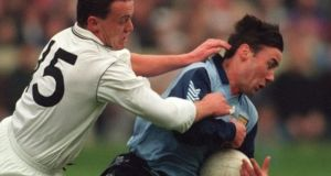 Kildare's Brian Nolan (left) and Dublin's Paul Curran during the 1993 football league. Photograph: Billy Stickland/Inpho