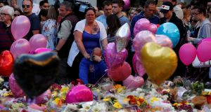 Charlotte Campbell, mother of Manchester Arena attack victim Olivia Campbell, and stepfather Paul Hodgson pay their respect in St Ann's Square for the victims in central Manchester. Photograph: Stefan Wermuth/Reuters
