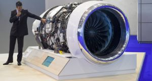A visitor looks at the Safran turbojet engine  at  the European Business Aviation Convention and Exhibition  Photograph:  AFP