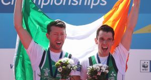 Mark O'Donovan (L) and Shane O'Driscoll on the podium after their European success. Photograph: Martin Divisek/EPA