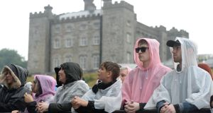 Slane concert-goers battled the mudslides and opening skies at Gun N'Roses as the teeming rain really took hold. Photograph: Dara Mac Dónaill / The Irish Times