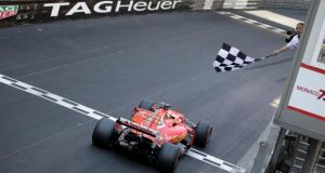 Ferrari's Sebastian Vettel crosses the finish line to win the  Monaco Grand Prix in  Monte Carlo. Photograph: Max Rossi/Reuters