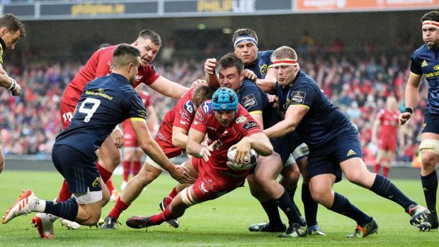 Irish man Tadhg Beirne scores Scarlets' fourt try against Munster. Photograph: Billy Stickland/Inpho