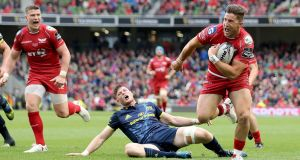 Scarlets DTH Van der Merwe runs in for a try against Munster in the Guinness Pro12 final at the Aviva Stadium. Photograph: Dan Sheridan/Inpho