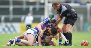 Laois's Charles Dwyer, Wexford's John Tubritt and Laois's Ross King become involved in an off the ball tussle during the Leinster senior hurling championship quarter-final at  O'Moore Park, Portlaoise. Photograph: Tommy Grealy/Inpho