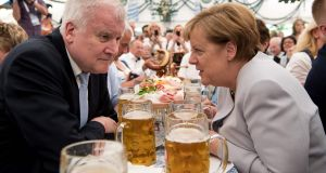 German Chancellor Angela Merkel  and Horst Seehofer  in a beer tent during a joint campaigning event of the Christian Democratic Union and the Christian Social Union  in Munich.   Photograph:  AFP/Getty Images