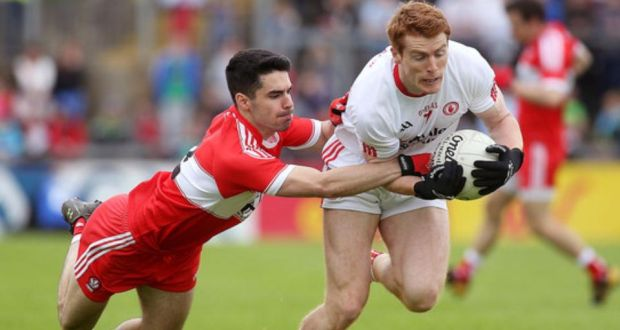 Tyrone s Peter Harte is tackled by Derry s Niall Keenan during his side s  comfortable Ulster championship win 0b1080bb2
