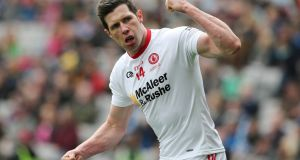 "Sean Cavanagh celebrates scoring a point in the victory over Derry at Celtic Park. ""There is serious competition for places at the moment. I am seeing it there in training. Whether that is good enough, time will tell."" Photograph: Lorraine O'Sullivan/Inpho"