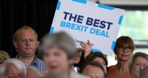 An attendee holds a placard reading 'The Best Brexit Deal' behind prime minister Theresa May, during a Conservative Party campaign event in Twickenham, London, on Monday. Photograph: Chris J Ratcliffe/Bloomberg