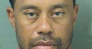 Tiger Woods was booked into the Palm Beach County jail on Monday after he was arrested by police in Jupiter, Florida. Photograph: Reuters