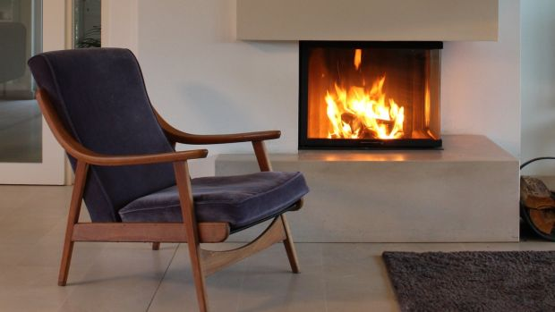Denise Ryan's fireplace, with the Knoll chair rescued from her parents' garage
