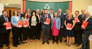 SDLP leader Colum Eastwood with the party's candidates during the launch of the party's election manifesto at the Crescent Arts Centre in Belfast.