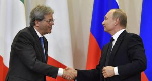 In plain sight: Italy's prime minister, Paolo Gentiloni, met President Vladimir Putin this month in Sochi.  Photograph: Yuri Kadobnov/Pool/EPA